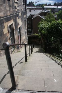 "[Walk in] Patrick Geddes Steps, Patrick Geddes was an Edinburgh based architect, planner, and early green thinker often cited as the source of the term ""Think Global Act Local"".  Image Source, Jones Bob,  https://commons.wikimedia.org/wiki/File:Patrick_Geddes_Steps_-_geograph.org.uk_-_896501.jpg (CC BY-SA 2.0)"